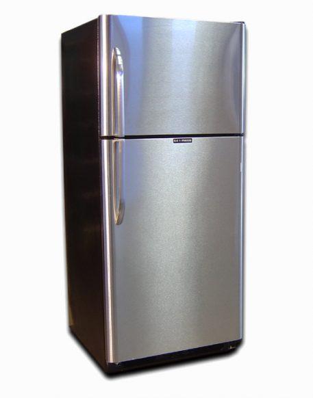 Stainless steel fridge with top freezer doors closed