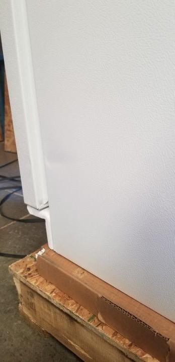 crease on right side of fridge