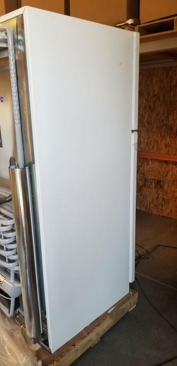 dent on left side of fridge